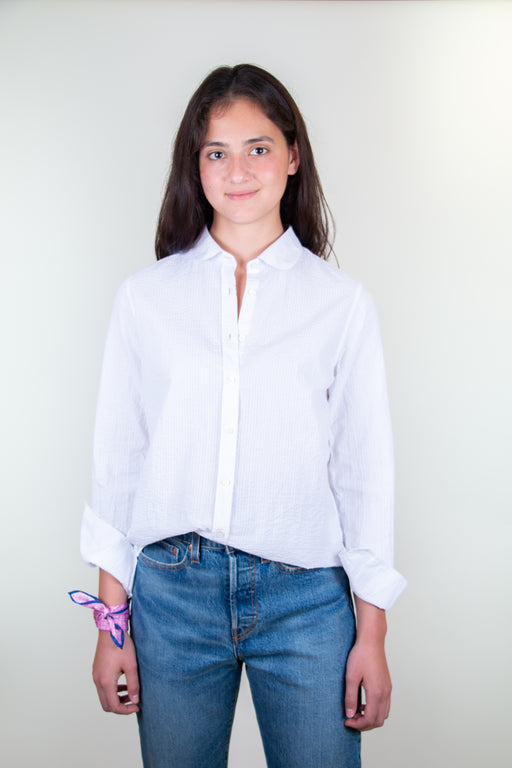 Model wearing white crinkle cotton shirt with peter pan collar