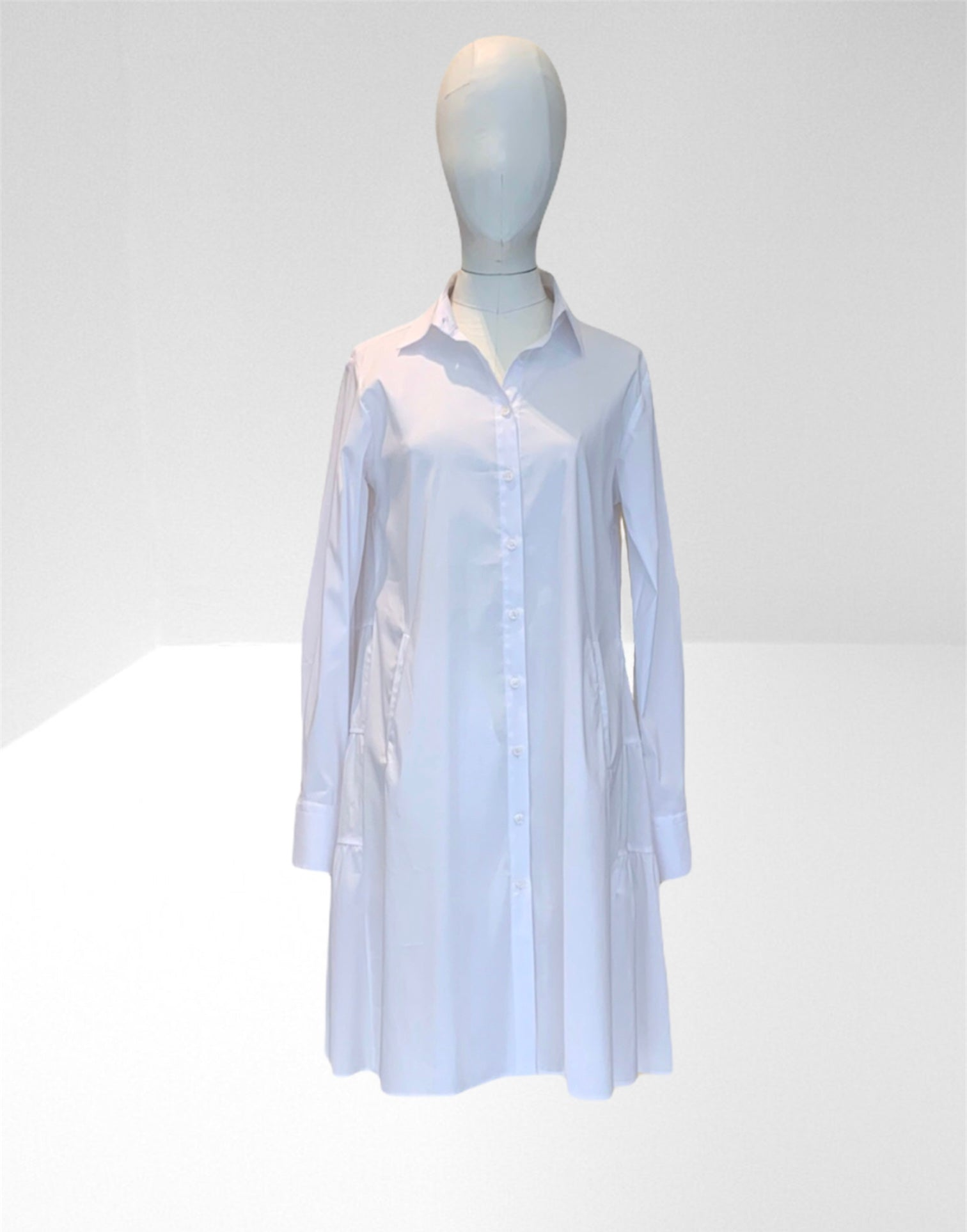 White trapeze back shirtdress