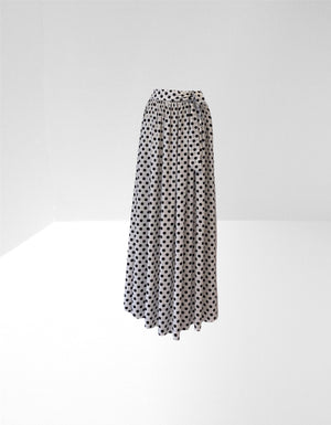 White cotton long skirt with black spot.