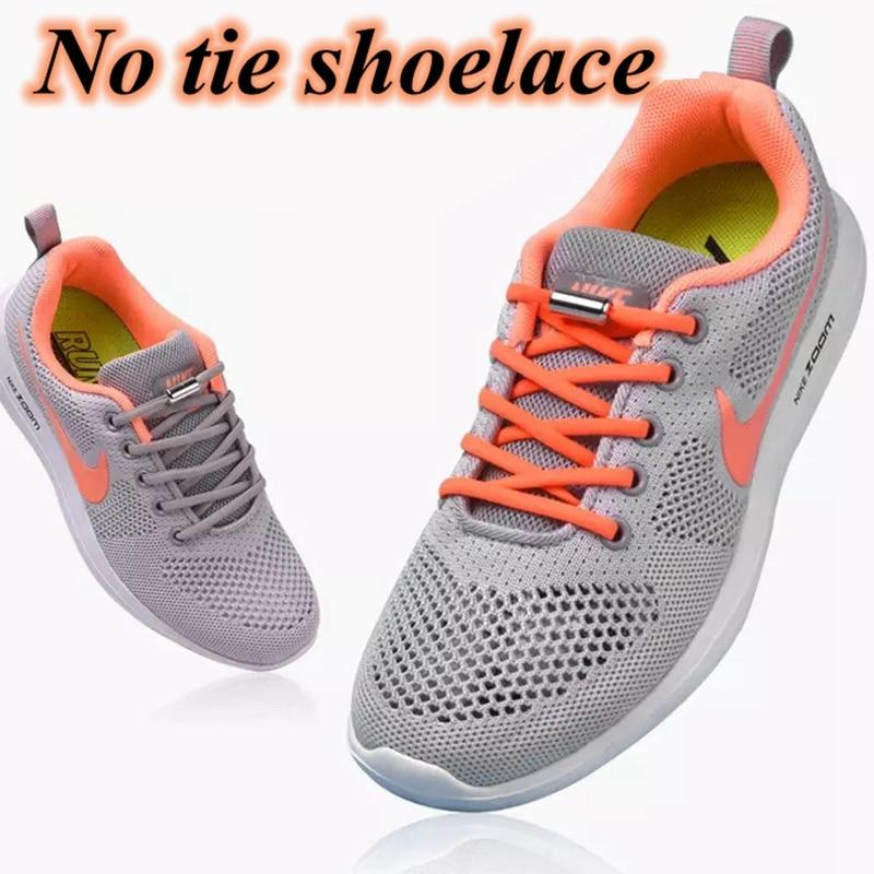 No tie shoelaces for kids adults and runners installed on pair of adult sneakers