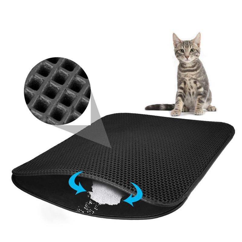 Non Slip Waterproof Pet Cat Litter Mat EVA Double Layer showing holes in mat and how litter sand gathers in bottom layer