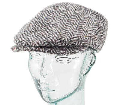 Front view of a black herringbone heavyweight tweed vintage style cap made by Hanna Hats
