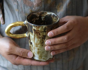 Rustic large gold handle mug