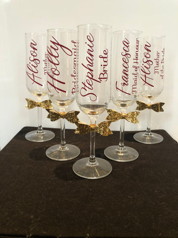 Champagne flute with glitter bow