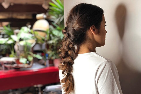 Brunette girl wearing braids