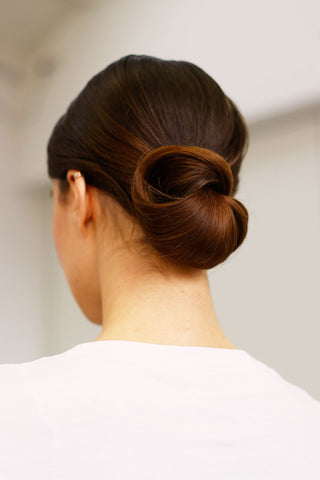 Brunette girl wearing hair in low bun
