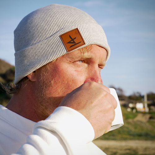 Gunnar Asmussen drinking coffee wearing jibe wear hat