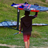 Mario Kümpel Syrferzyzz carrying wivndsurf board and foil in windsurf clothing
