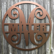"Load image into Gallery viewer, Metal ""Fancy"" Circled Monogram with Custom Last Name - Woodpost Metalworks"