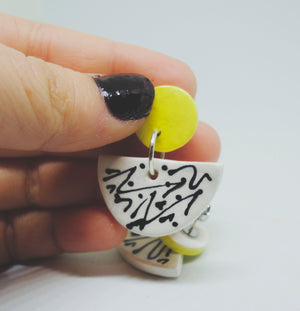 yellow black and white wiggle line earrings