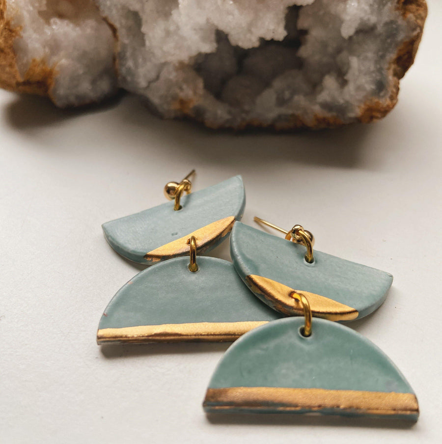 matte blue and gold dangle earrings
