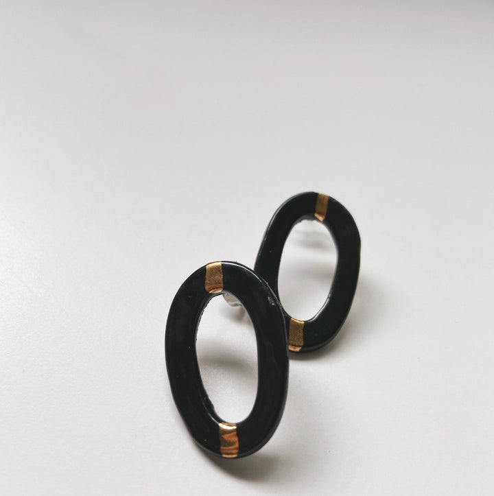TAYLOR- Black and gold oval studs - gloriafaye