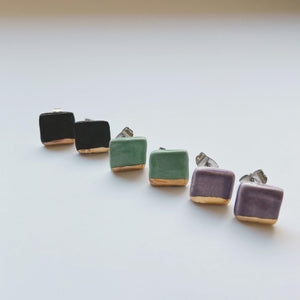 square gold dipped ceramic studs