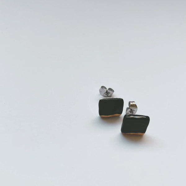 square black and gold dipped ceramic studs