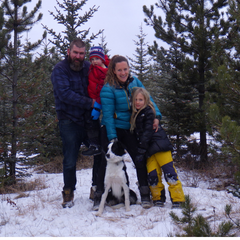 family in the forest with dog
