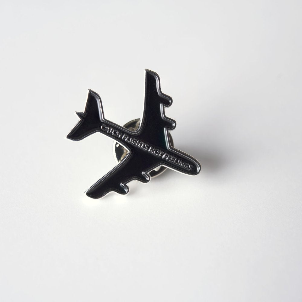 The Traveler: Catch Flights Not Feelings Pin