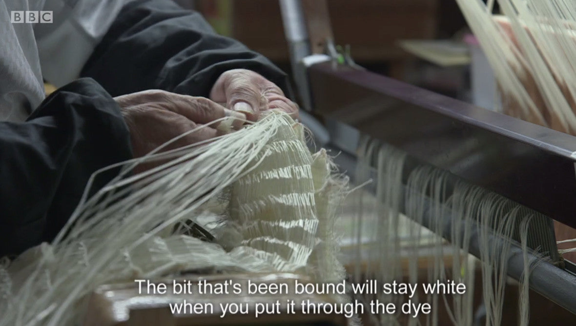 The silk is expertly bound before dyeing