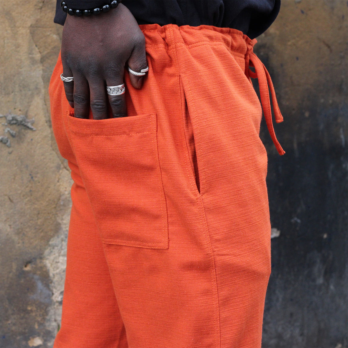 Unisex Ribbed Cotton Shing Mai Trousers Orange front, on model