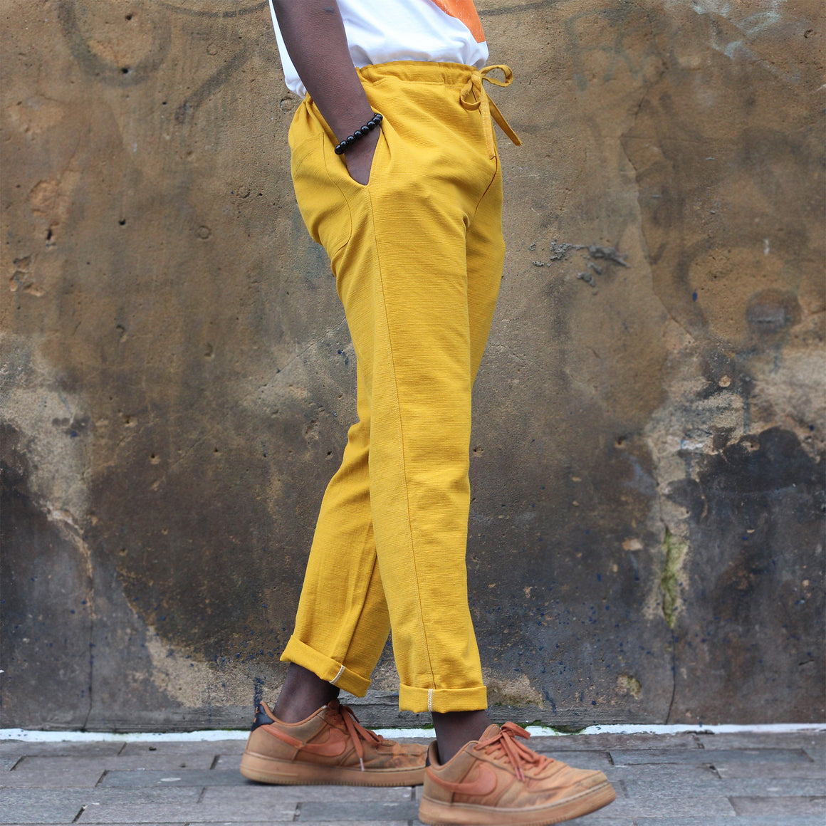 Unisex Ribbed Cotton Shing Mai Trousers Yellow front, on model