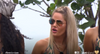 Female contestant wearing the Love Island aviator sunglasses