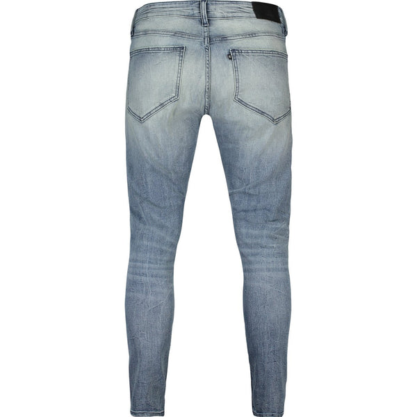 Skinny fit jeans with heavy destroys in faded indigo stretch denim - CR7 Cristiano Ronaldo