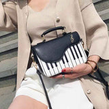 Factory Outlet: Leather Piano Handbag
