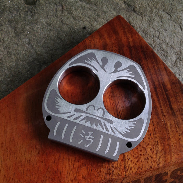 Dirte Knives - Paperweight - Dirte Daruma - Stainless Steel - Front