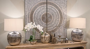 Carved Wood Wall Art with a silver finish