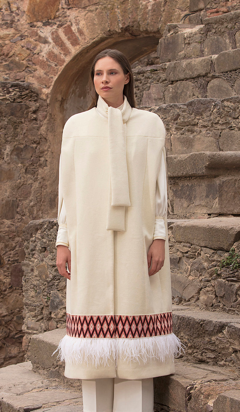 Elegant white coat with intricate stitched piece