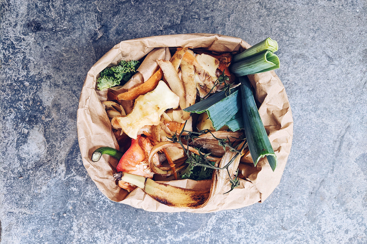 compost caddy full of food scraps and peelings