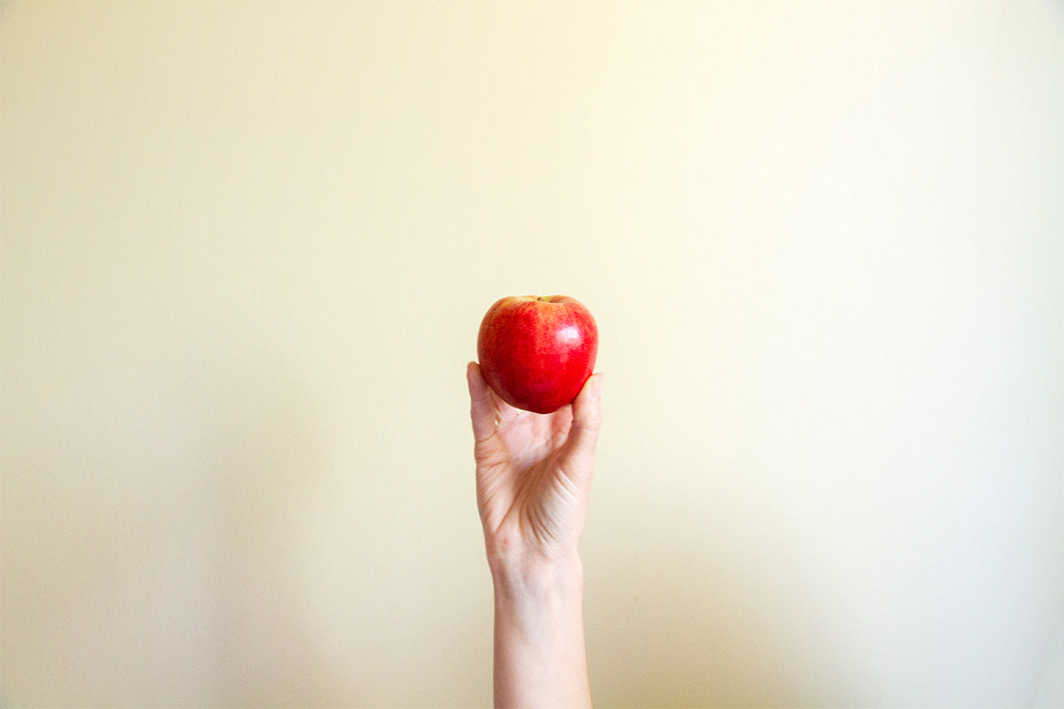 holding up a royal gala apple