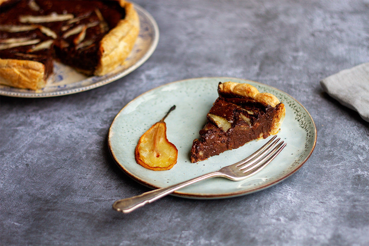 slice of pear and chocolate torte baked by rustic cakes cornwall for fruutbox