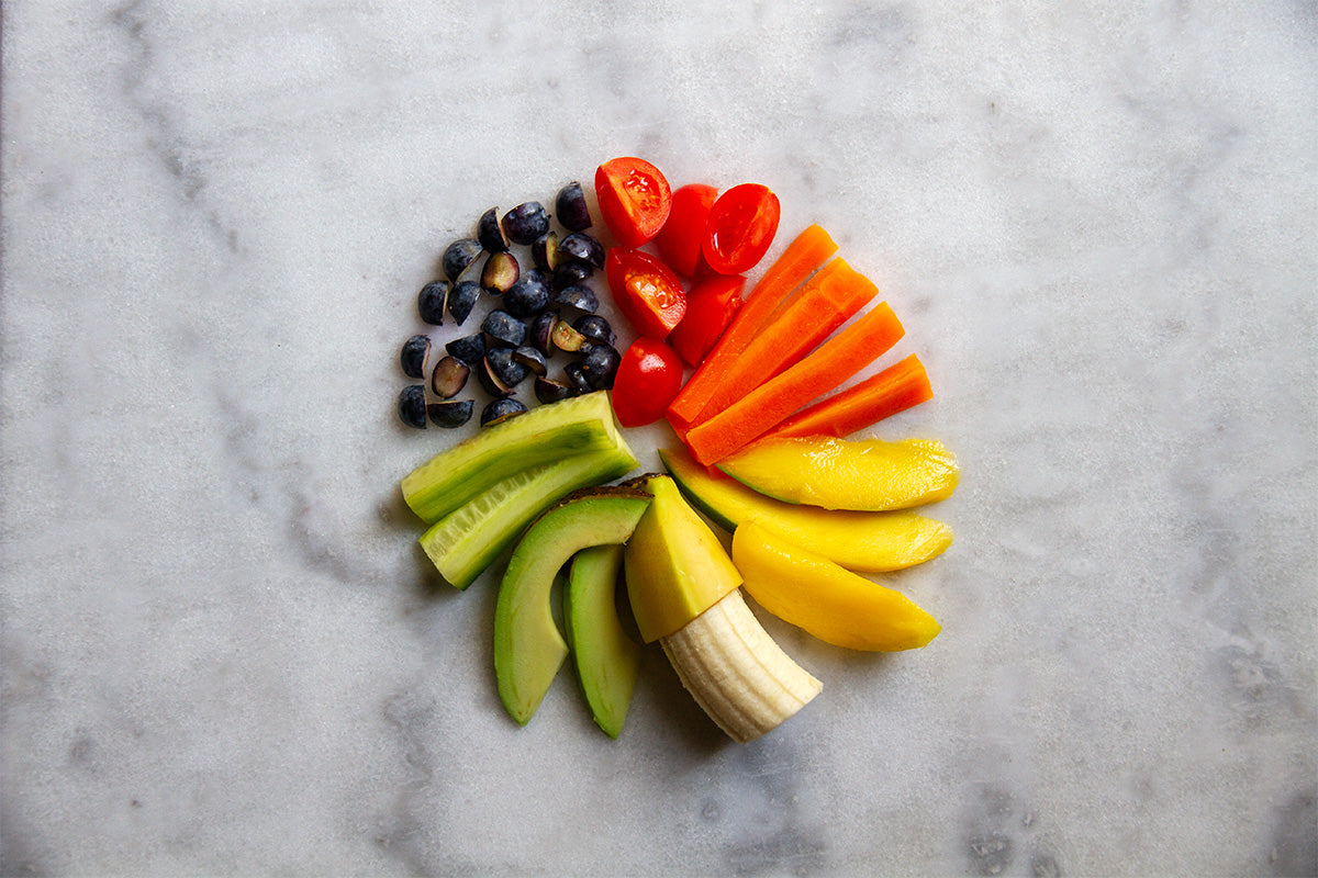 colour wheel made of fruit and vegetables cut up for a baby or toddler to eat