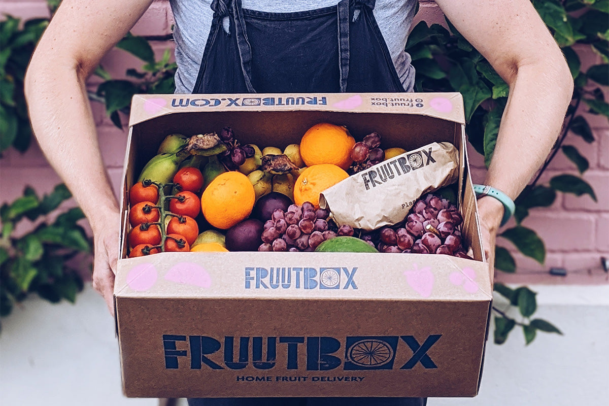 holding up a fruutbox