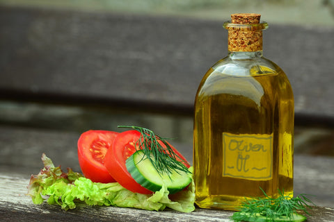 Olive oil bottle with veggies