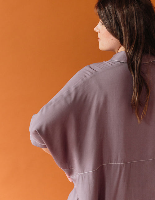 The Audrey blouse is oversized, button down and has dolman sleeves. The contrast stitching adds a lovely detail. The Audrey blouse is perfect for pregnancy and postpartum months. Machine wash gentle, line dry. Available in colors black and plum.