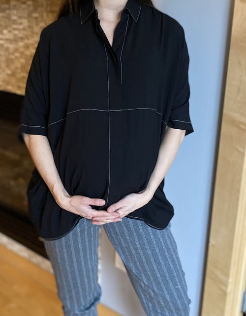 Audrey Blouse and Coco pants together make a lovely pair!  The Audrey blouse is oversized, button down and has dolman sleeves. The contrast stitching adds a lovely detail. The Audrey blouse is perfect for pregnancy and postpartum months. Machine wash gentle, line dry. Available in colors black and plum.