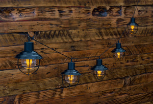 LitezAll LED Edison Bulb 5 Piece Metal String Lights Against a Wall