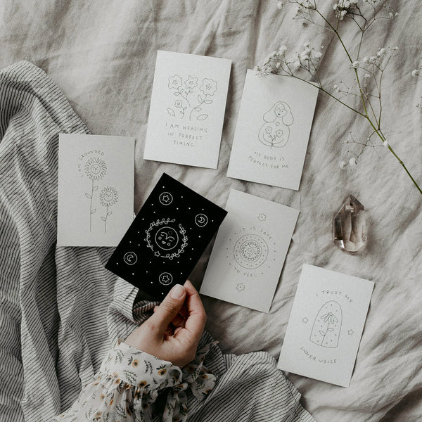 Affirmation Cards laid out on a bed to choose a card for the day