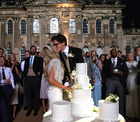 Ellie Goulding wearing Ralph & Russo caplet over a white skirt on her wedding day