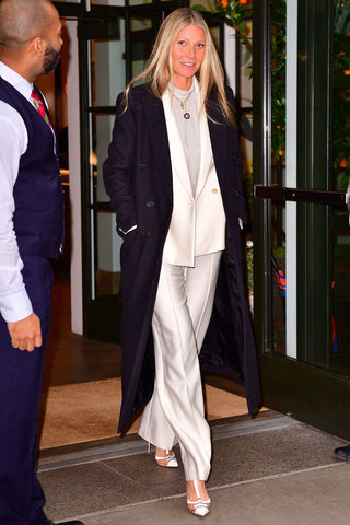 Gwyneth Paltrow wearing a white silky suit