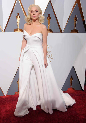 Lady Gaga in Brandon Maxwell bridal inspired jumpsuit for the Oscars