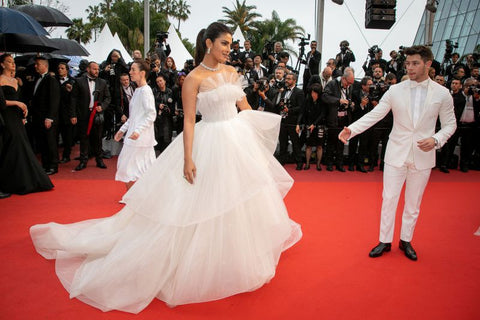 Priyanka Chopra alongside husband Nick Jonas wearing a George Hobeika wedding inspired gown at Cannes Film Festival