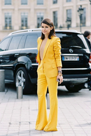 Mira Duma in yellow suit