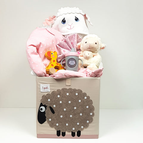 A baby gift basket with a trendy storage cube filled it with a sleeper, Precious Moments Hooded Towel, plush toy, receiving blanket, pull toy and sippy mug too!