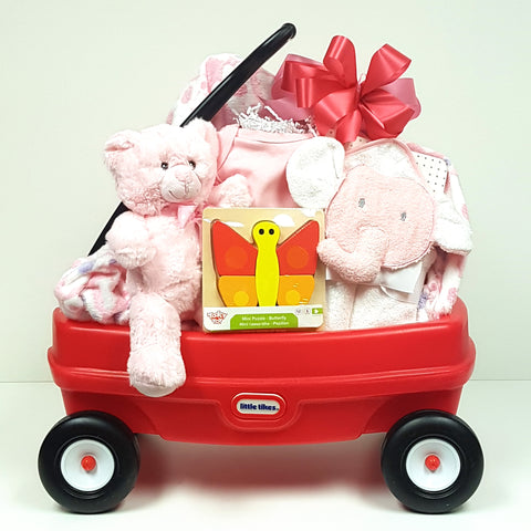 A perfect baby gift basket that comes with a little red wagon nestled with a plush baby blanket, onesie, hooded towel, cuddly teddy and classic baby puzzle.
