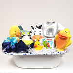A bath tub gift basket brimming with Nuby's bath book, duckie sponge, animal hooded towel, Mama duck & baby plush, receiving blankets, onesie, baby bib and animal wash cloths too!