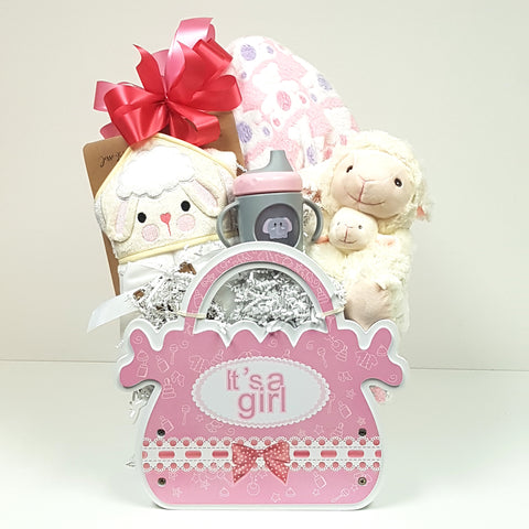 A keepsake baby wood crate gift box loaded it with a soft plush blanket and hooded towel, baby's first sippy cup and a mama with baby plush.