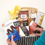 A professional and experienced designers creating the perfect gourmet gift basket just for your recipient.