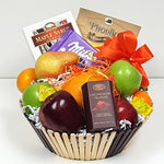 Nestled in an assortment of fruits there's a treasure of truffles, chocolates & yummy cookies in a fruit gift basket.